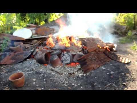 Firing Clay Pots - Elvie's Pottery Sea View Farm, Antigua