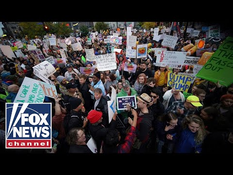 protesters-light-maga-hats-on-fire-outside-of-'keep-america-great'-rally-in-minnesota