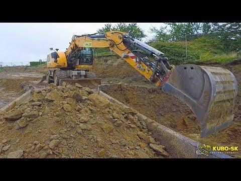 Loading Tatra Terrno1 Truck With Liebherr A918  Wheeled Excavator