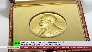 Russia's richest man buys Nobel prize medal only to return it