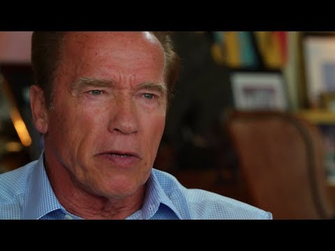 Arnold Schwarzenegger speaks with Guenther Ziesel