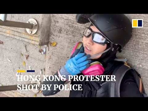 Hong Kong protester shot by police