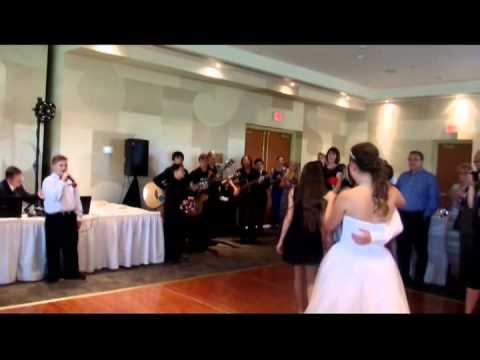Music students surprise two brides at their wedding