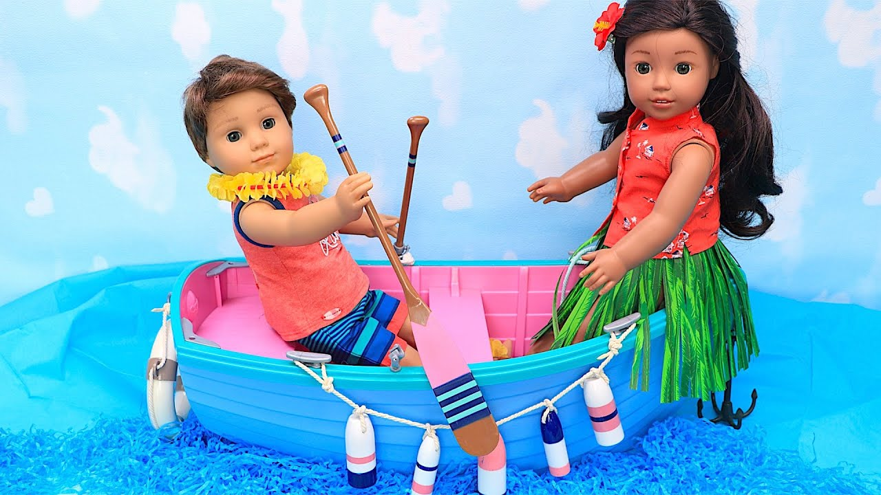 Doll friends pretend play fishing on a boat for treasure
