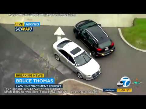 RAW VIDEO: Robbery suspects dodge pit maneuver, flee moving vehicle during LA chase | ABC7