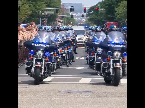 Procession brings fallen officer to funeral home