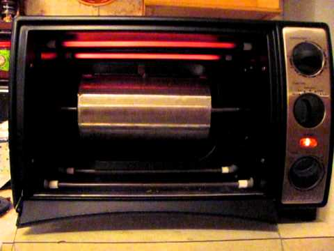 Rotiserrie convection oven coffee roaster with stainless steel drum.