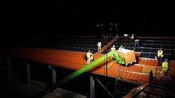 Installing Photo Voltaic Panels - Solar Farm on Roof in Germany