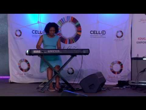 Young pianist playing at Jacob G Zuma RDP Education Trust Christmas Party