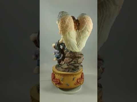 Colorful guardian Angel with musical box