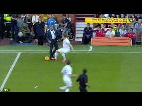 Jose Mourinho runs onto the pitch and fouls England player