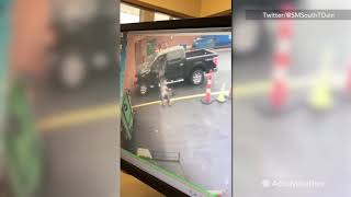 Guy slips on ice getting out of truck, spilling coffee