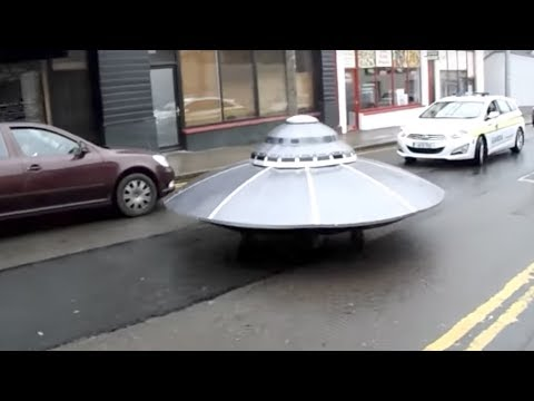 Irish Police Escort Mysterious UFO Down Main Street