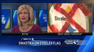 Swastika spotted over a Steelers logo on a flag