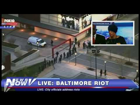 FNN: Baltimore Protesters clash with Police and Riot, Nepal Quake Disaster, Aurora Shooter Trial