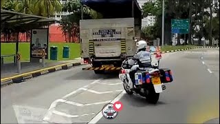 2018 singapore traffic police in action against lorry and cyclist
