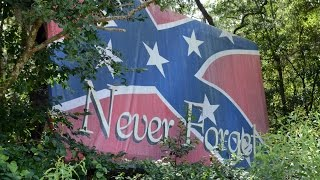 """A billboard showing a Confederate flag and the words """"Never Forget"""" sits at the corner of S.C. 462 and Bees Creek Road in Jasper County, S.C."""