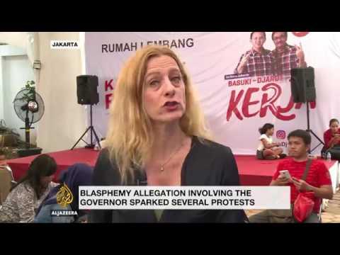 Jakarta's Christian governor accused of blasphemy
