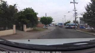 Bus Overtaking at Stop Light - Red Hills Road, Jamaica