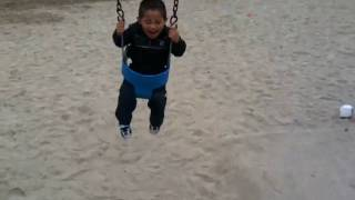 Drew swinging at the Park