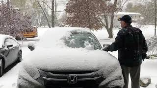"""That guy"": Cleaning snow off the car 