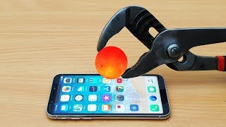 EXPERIMENT Glowing 1000 Degree METAL BALL vs iPhone X thumbnail