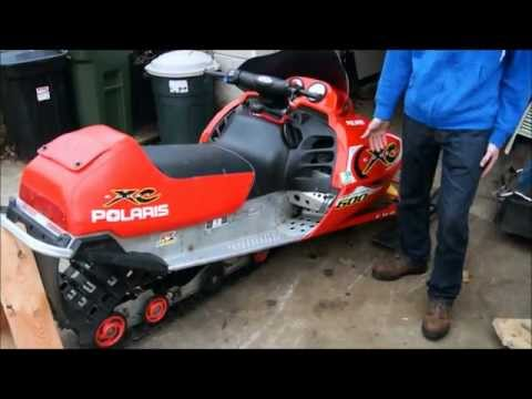 how to change a track on a snowmobile