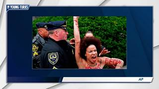 Topless Protester Charges Bill Cosby