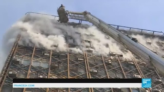 Iran: Dozens of firefighters feared dead after Tehran high-rise collapses