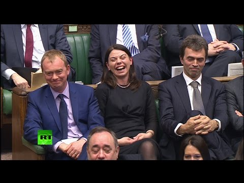 "Laughs as May says ""world needs liberal democratic values"""