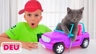 Vlad und Niki spielen mit Kätzchen