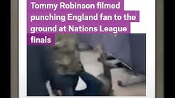 Tommy Robinson filmed punching England fan to the ground at Nations League finals