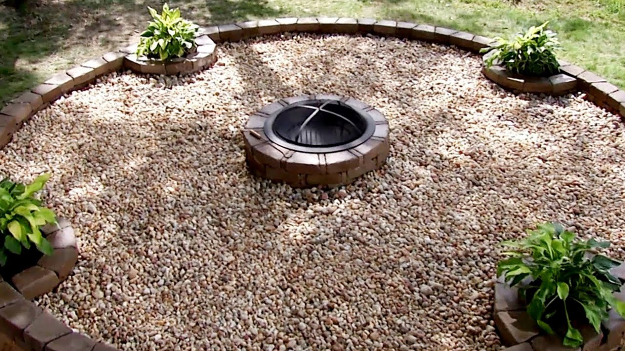 Backyard fire pit building tips diy network youtube for How to build a river rock patio