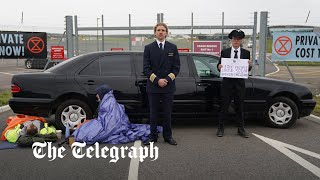 video: Extinction Rebellion: Activists barricade airport with limousine in private jet protest