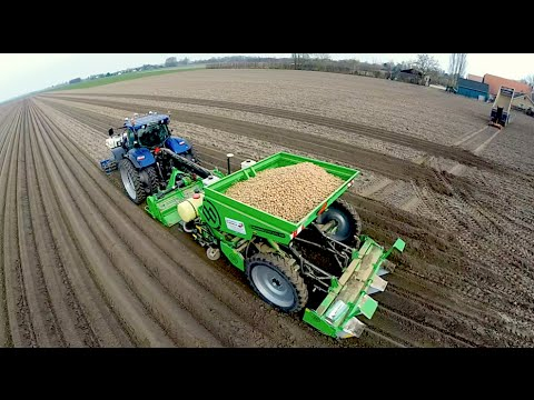 Potato Planting    New Holland T7070 Blue Power + Miedema Structural belt planter Loonbedrijf Breure