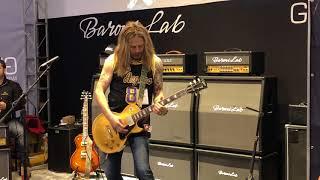 Doug aldrich jamming at the baroni lab booth.