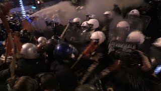 Greek police fire tear gas at anti-Obama protesters