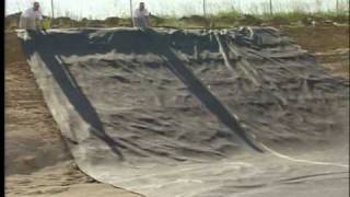Install geotextile - down hill.avi