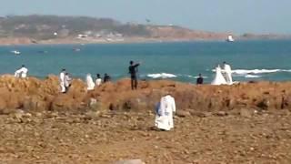 China Qingdao brides and grooms beach photo shooting