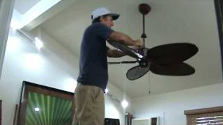 Adjusting the 'set screws' to a wobbly ceiling fan