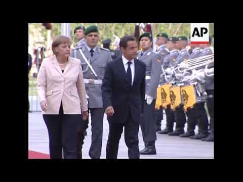 Sarkozy arrives in Berlin, welcomed by Merkel, presser