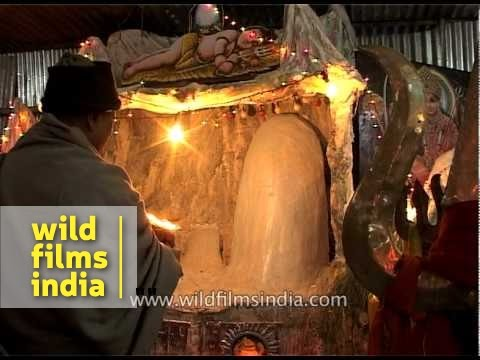 Pilgrims attend phallus aarti during Amarnath Yatra
