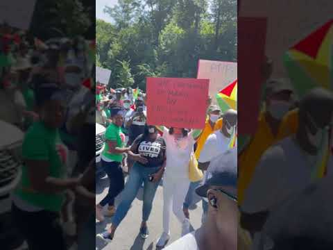 Protesters in Anti Racism Guyana Protest Confront Government Agent.