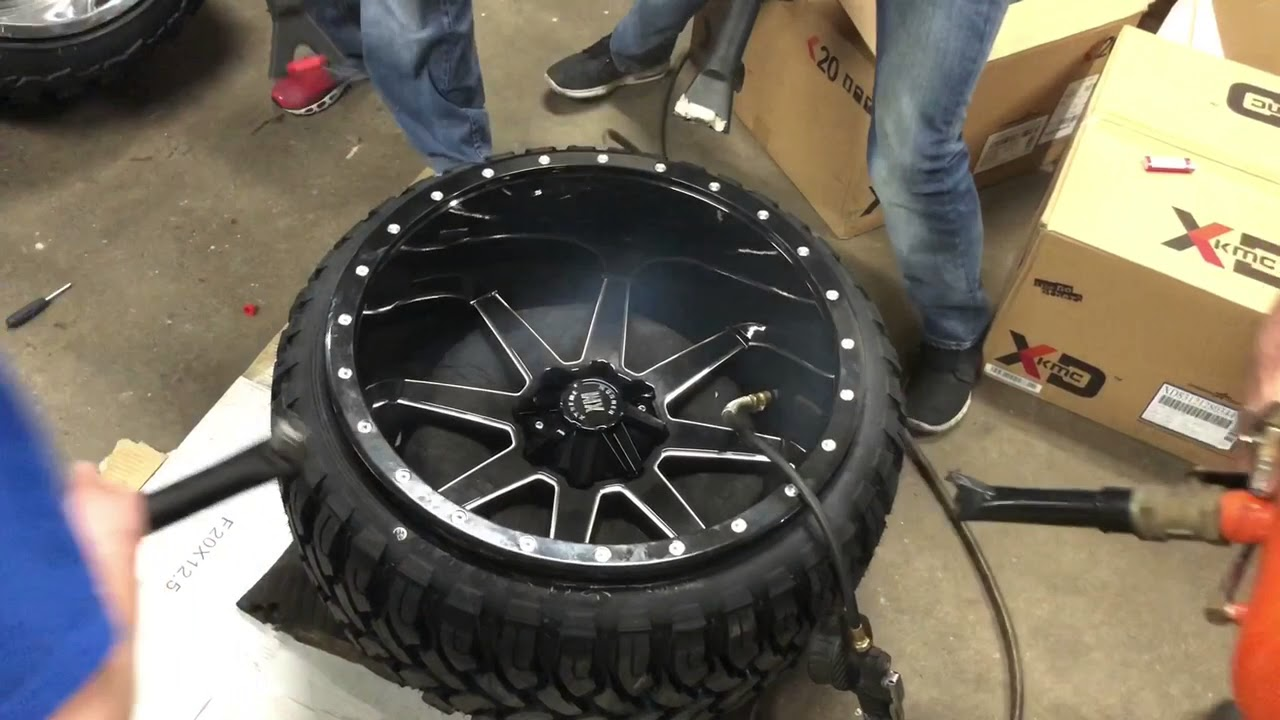 Stretching 24x14 Xtreme Mudder wheels truck tires - YouTube