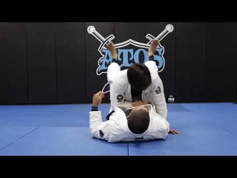 Arm drag from the closed guard