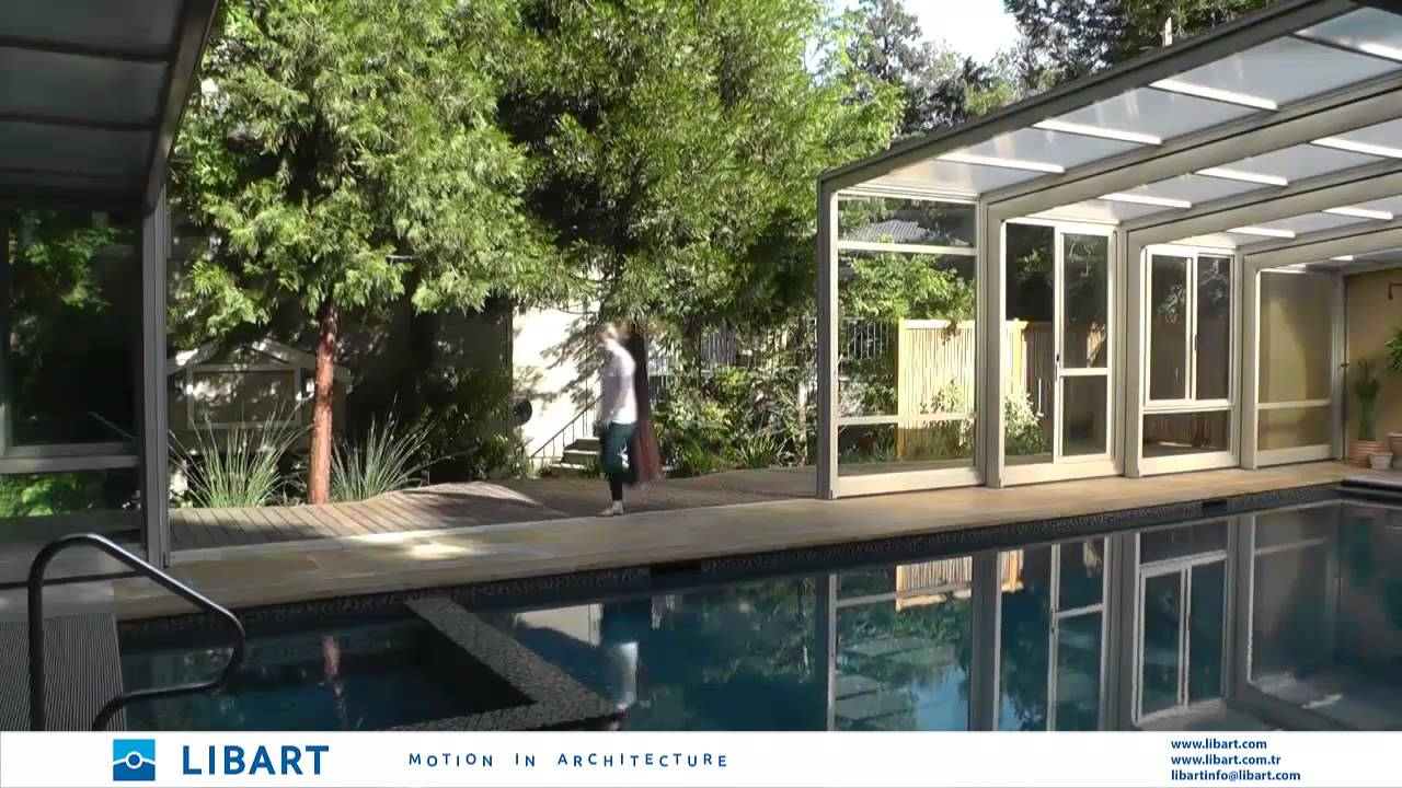 Woman Opens Retractable Pool Enclosure