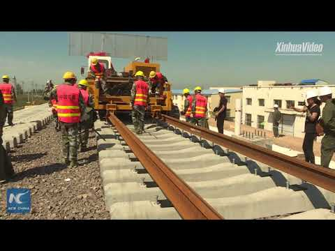 Watch how tracks are laid for China's high-speed rail