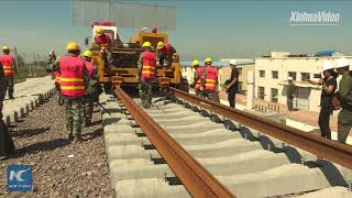 Watch how tracks are laid for China
