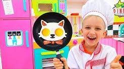 Vlad und Nikita kochen Frühstück für ihre Mama