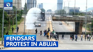 Police Fire Teargas, Water Canon At #ENDSARS Protesters In Abuja
